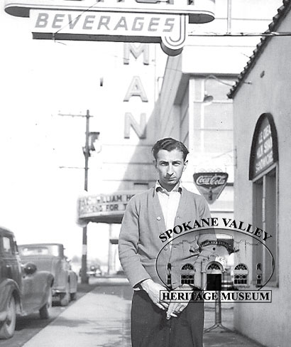 Jan Pasquale stands in front of the Midway Café in Dishman in about 1940